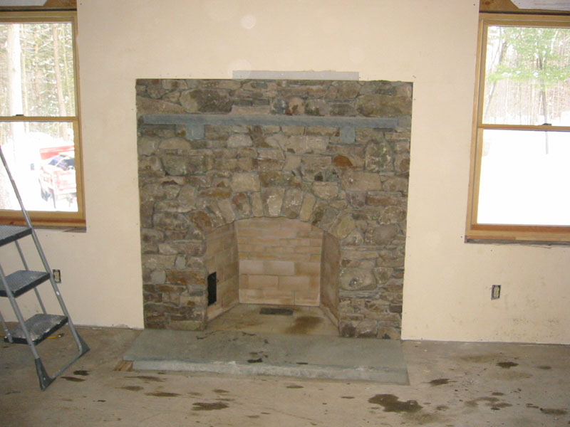 Arch fireplace for Field stone fireplace