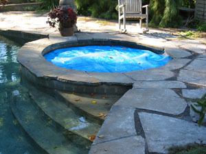 Flagstone Patio surrounding Hot Tub and Pool