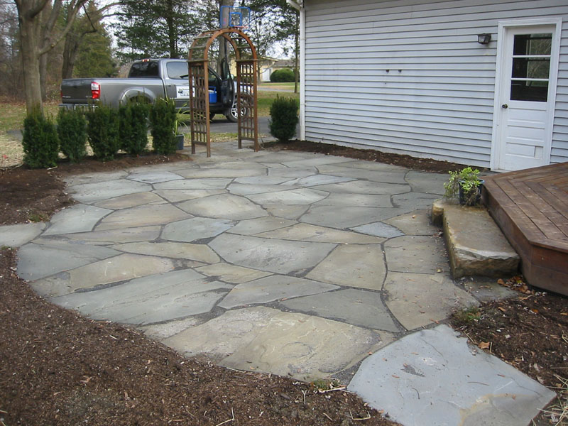 More stone patio pictures natural flagstone patios and for How to build a river rock patio