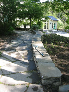Natural Flagstone Walkway with Stone Wall