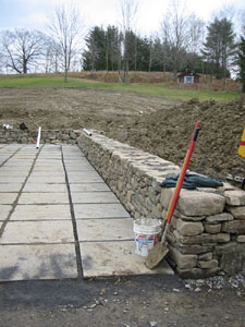 Stone Wall and Square Flagstone Patio