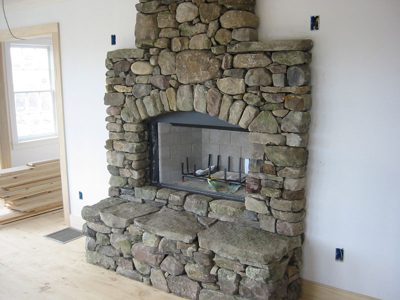 Stone fireplace pictures natural stone manufactured stone and fieldstone - Images of stone fireplaces ...