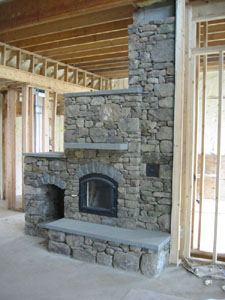 Fieldstone Fireplace with Wood Holder