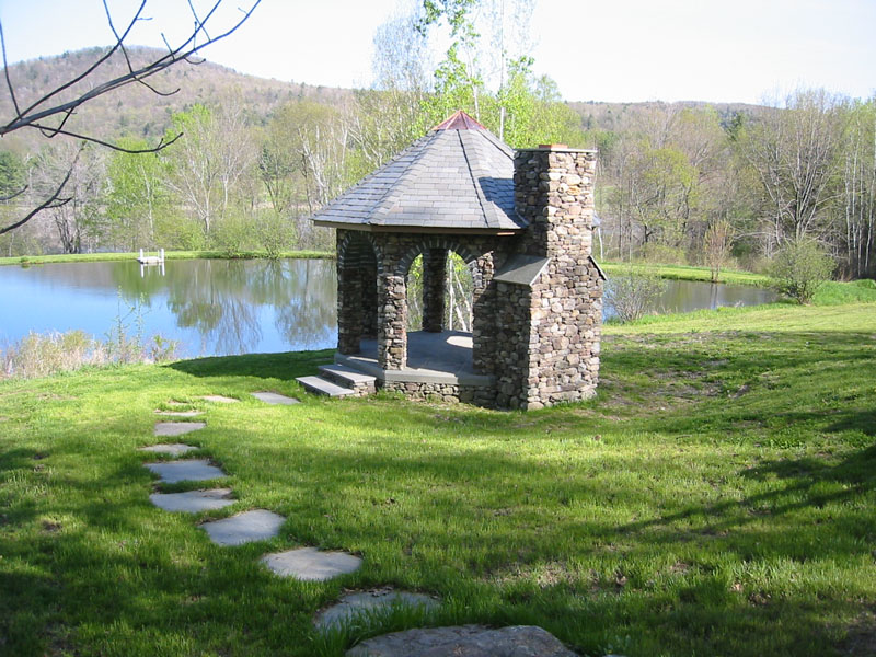Specialty stonework pictures stone gazebo stone bench for Outdoor gazebo plans with fireplace