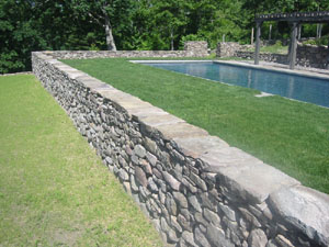 Stone Wall surrounding Pool