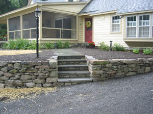 Stone Wall with Flagstone Walkway and Bluestone Steps
